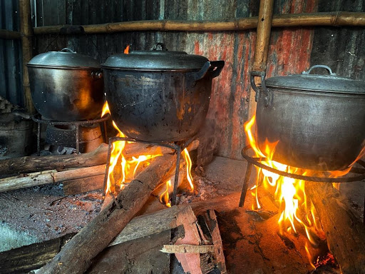 Cooking over a makeshift wood fire. Billions of people globally don't have access to clean cooking methods